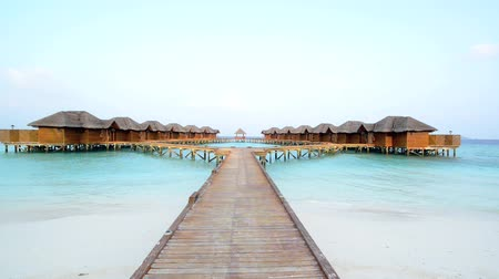 Мальдивы : Over water bungalows with steps into amazing green lagoon