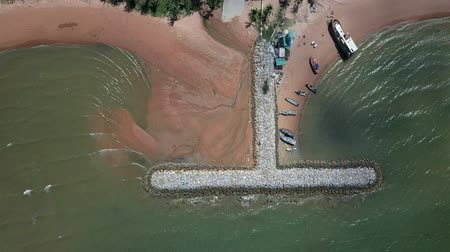 wall building feature : Aerial. Stone wave breaker into the sea at Pattaya, Chonburi, Thailand