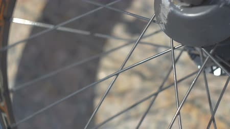 Bicycle wheel is spinning close up