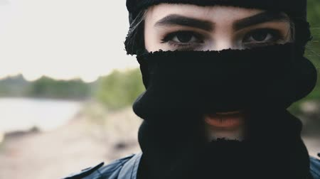 Girl in the black mask close up