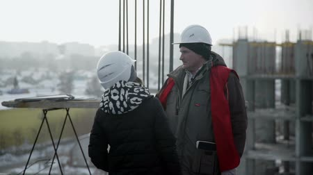 Brigadier talking to a woman standing on the roof of the building Stock Footage