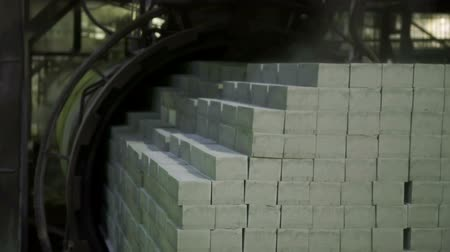 Stone blocks are stacked together in a factory Stock Footage