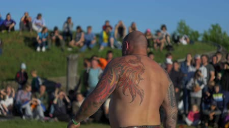 tatoo : Man is walking along the field slow motion