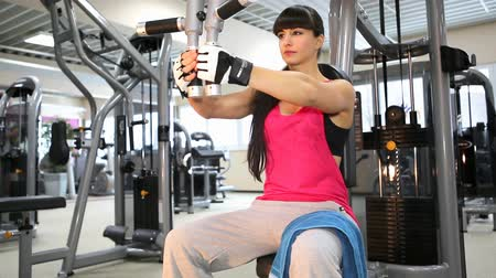 young woman in sport dress in a gym room