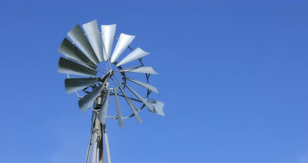 Old metallic windpump or water pumping windmill Stock Footage