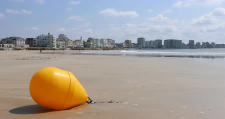 Yellow buoy on the beach of Sables dOlonne (Vendee, France) Stock Footage