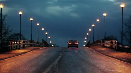 night scene : Cars on a bridge with streetlights. Stock Footage