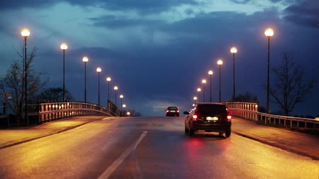 capital cities : Cars on a bridge with streetlights. Stock Footage