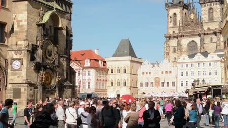 namesti : Old Town Square with people and Astronomical Clock - in background historical building - sunny day