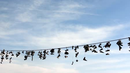 cordas : Shoes hang on a rope