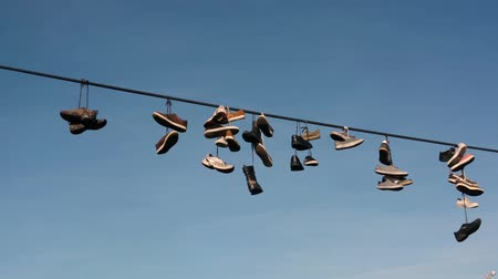 kable : Shoes hanging on a rope Wideo