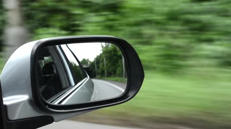 new car : ride in the car - reflection in the rearview mirror Stock Footage