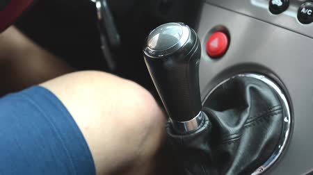 élvezet : A man drives a car - gearshift lever Stock mozgókép