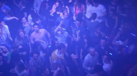 boates : People dancing at a party (disco) - stage lights Stock Footage