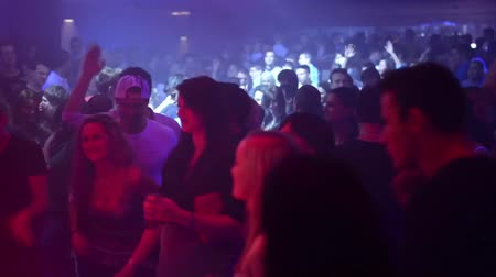 discotheque : People dancing at a party (disco) - stage lights Stock Footage