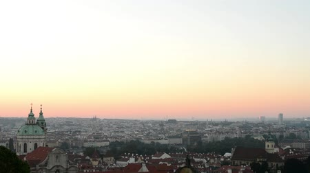 mala : Sunrise over Prague - roofs of urban buildings