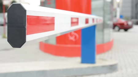 barriers : barrier in the parking lot - car in background Stock Footage