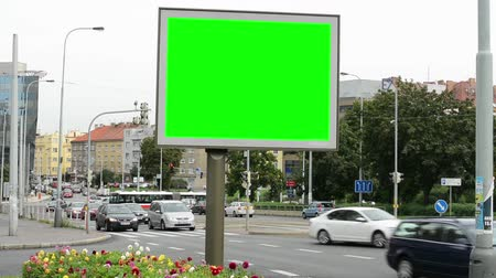 blank : billboard in the city near road and buildings - green screen - people with cars