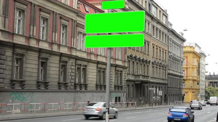 restraint : road signs - green screen - city ​​- urban street with cars - traffic jam