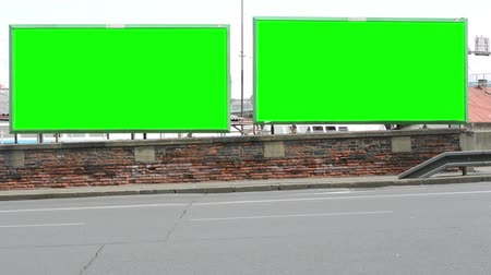 panel buildings : two billboards in the city near road - green screen  Stock Footage