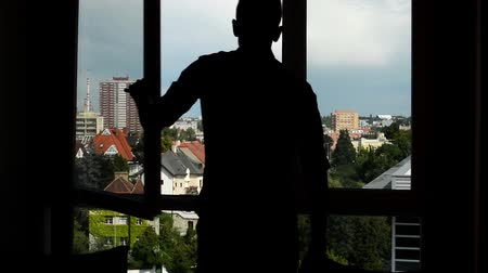 yedek : man close the window - silhouette - city (buildings with nature in background)
