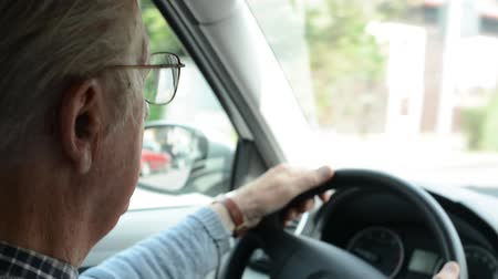 senior lifestyle : old man(senior) drives a car - head Stock Footage