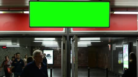 kolej : entrance to the subway - notice board (panel) - green screen - people Wideo