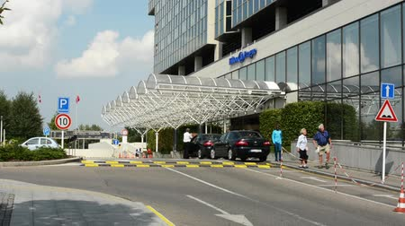 hilton : PRAGUE, CZECH REPUBLIC - SEPTEMBER 20, 2014: Hilton modern hotel - exterior - entrance - cars and people