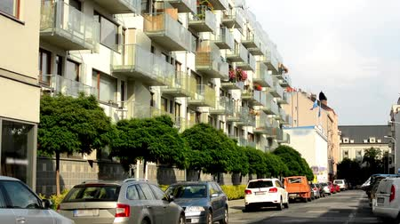 yerleşim : city - urban street with parked cars - flats (apartments) - sunlight Stok Video