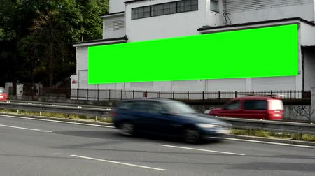 poszter : billboard on a building - green screen - street - road with cars - nature (trees
