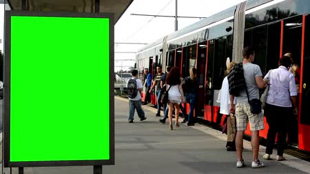 reklama : billboard in the city and buildings - green screen - commuter people - tram Wideo