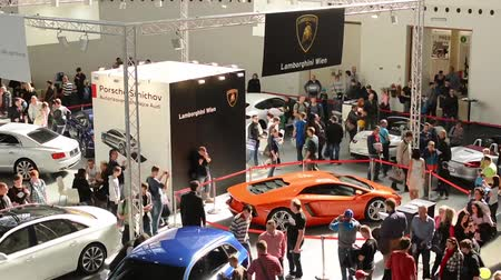 auto show : car exhibition - parked cars and people walking and watching cars - timelapse Stock Footage