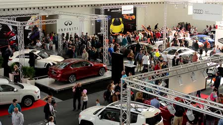 auto show : car exhibition - parked cars and people walking and watching cars - interior Stock Footage