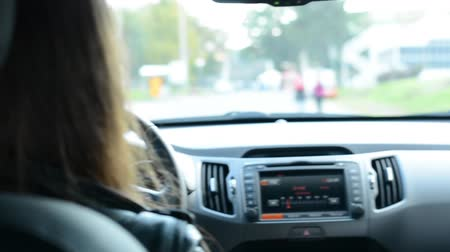 inside car : woman drives a car - dashboard, wheel and gear lever Stock Footage