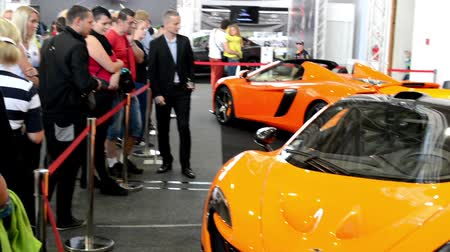 presented : McLaren cars (exterior) - people on exhibition