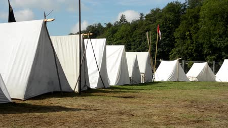 sátor : white block of tents - ground - forest (trees) - camp - sunny