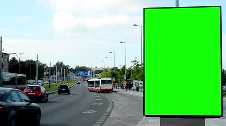 billboards : billboard in the city near road and buildings - green screen - people with cars - nature and bus stop Stock Footage
