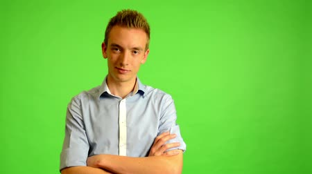 business man : man - green screen - portrait - young man smiles (man is happy)