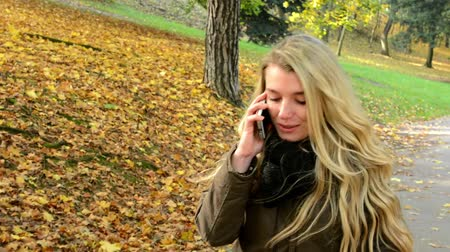 braces : woman on the phone (woman calling by smartphone) - woman walking in autumn park - woman smiles (happy)