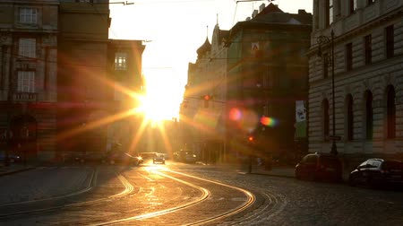 sunset city : city - urban street with cars - sunrise - buildings
