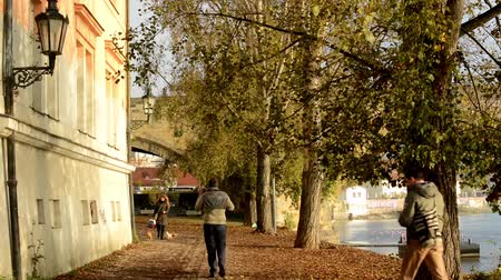 europeu : old street - urban buildings - autumn trees - sun rays - people - river