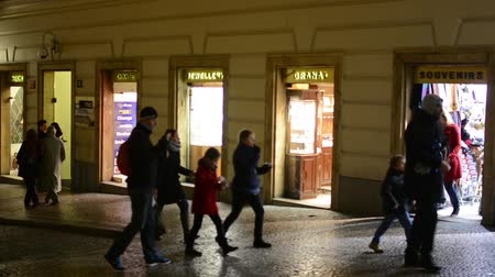 ночная жизнь : small urban shops on the street - people walking - night city (night life)