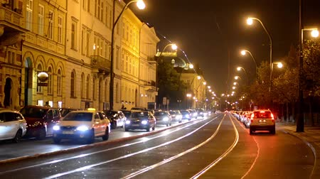 Прага : night city - night urban street with cars and trams - lamps(lights) - car headlight