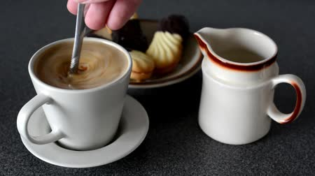 desszertek : coffee with milk - sweets (cookies) - stir coffee with spoon
