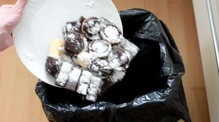 нездоровое питание : cookies and sweets - thrown into waste Стоковые видеозаписи