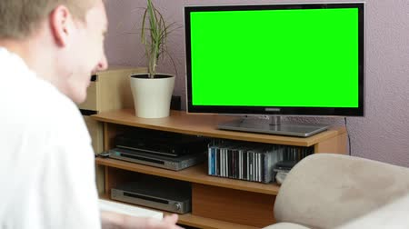 гостиная : Man watches TV(television) - green screen - man laughs