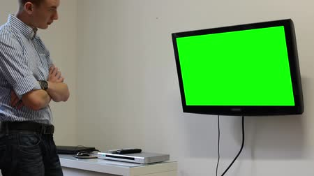 tv screen : Man watches TV(television) - green screen