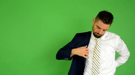 получать : business man wears jacket - green screen - studio
