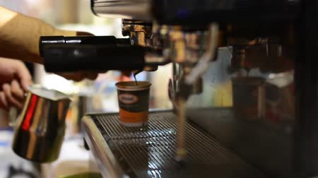 black coffee : barista prepares coffee on coffee machine - cup