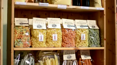 olive colored : colourful pasta (olive oil, flour etc.) in bags in shelf - shop